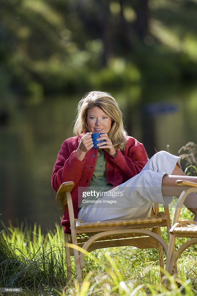 Woman drinking coffee : Stock Photo