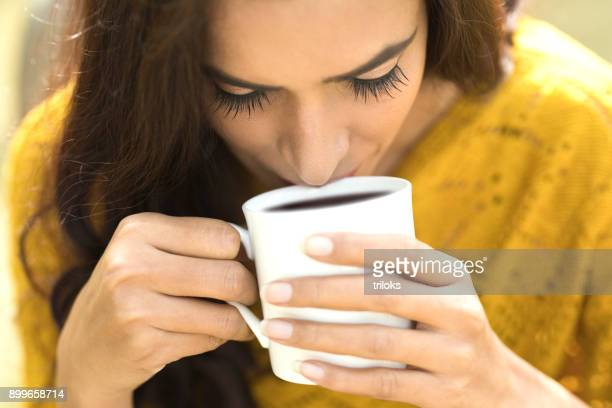 woman drinking coffee - black coffee stock pictures, royalty-free photos & images