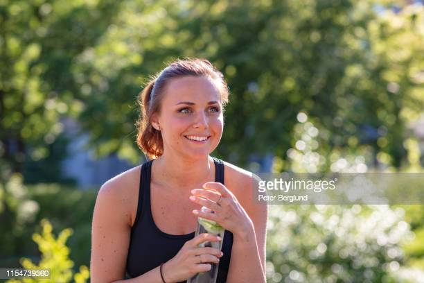 woman drinking cucumber water - detox stock pictures, royalty-free photos & images
