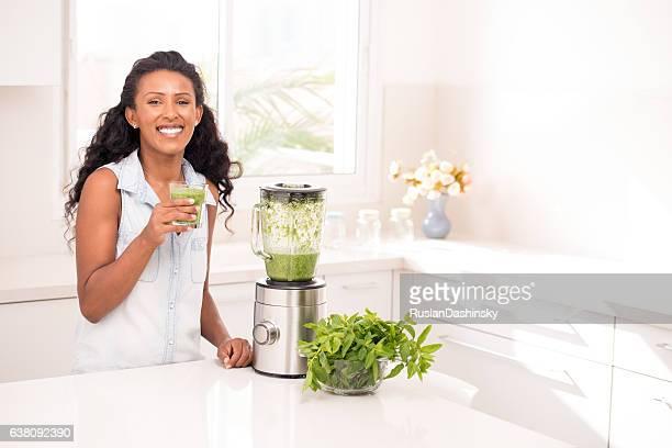 Woman drinking fresh lemonade.