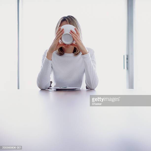 woman drinking from bowl - obscured face stock pictures, royalty-free photos & images