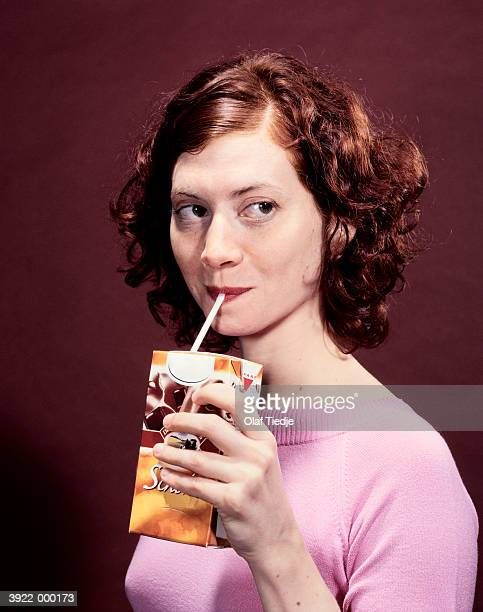 woman drinking from carton - juice carton stock photos and pictures