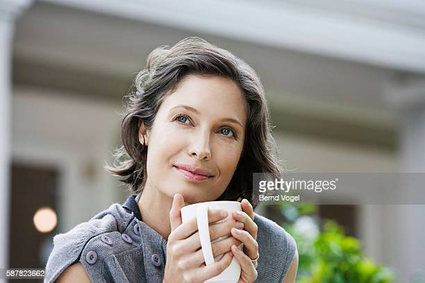 woman drinking from coffee mug - stereotypically upper class stock pictures, royalty-free photos & images