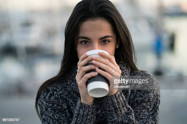 Woman drinking from takeway cup