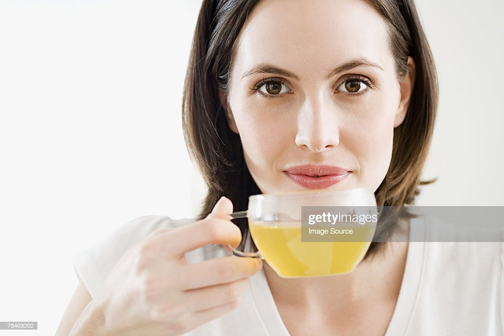 Woman drinking green tea : Stock Photo