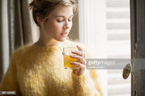 woman drinking herbal tea - herbal tea stock pictures, royalty-free photos & images