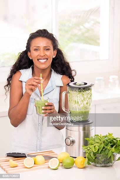 Woman drinking homemade lemonade.