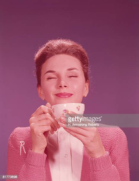 Woman drinking hot beverage. (Photo by H. Armstrong Roberts/Retrofile/Getty Images)