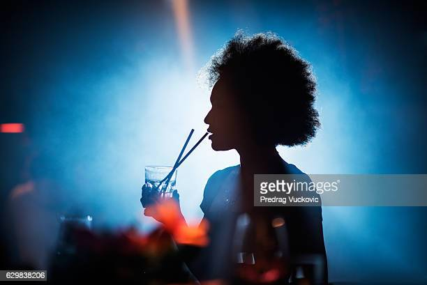 Woman drinking in the bar