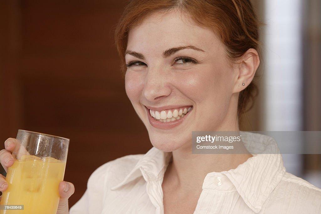 Woman drinking juice : Stockfoto