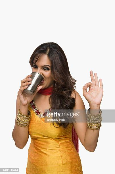 Woman drinking lassi the traditional Indian beverage