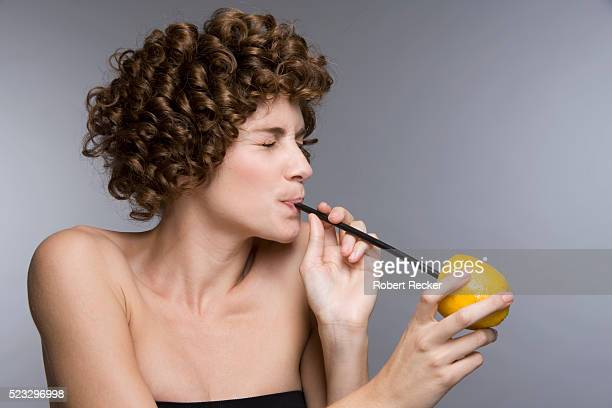 Woman Drinking Lemon Juice
