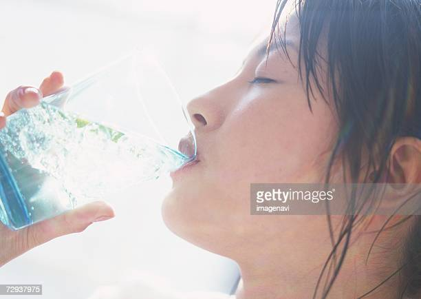 Woman drinking lime water