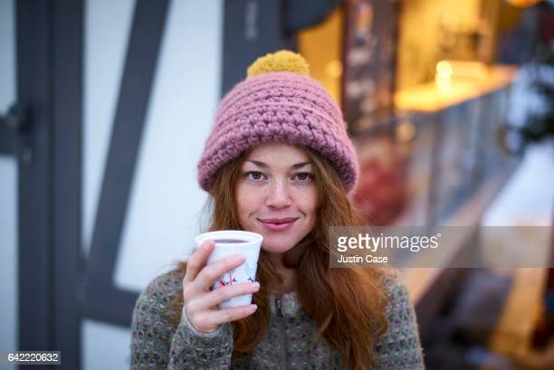 woman drinking mulled wine on Christmas market