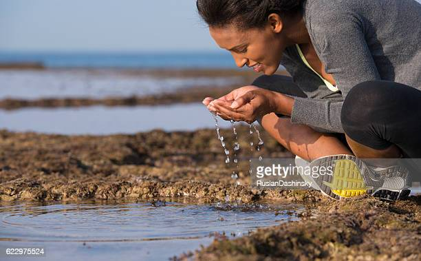 Woman drinking natural water.