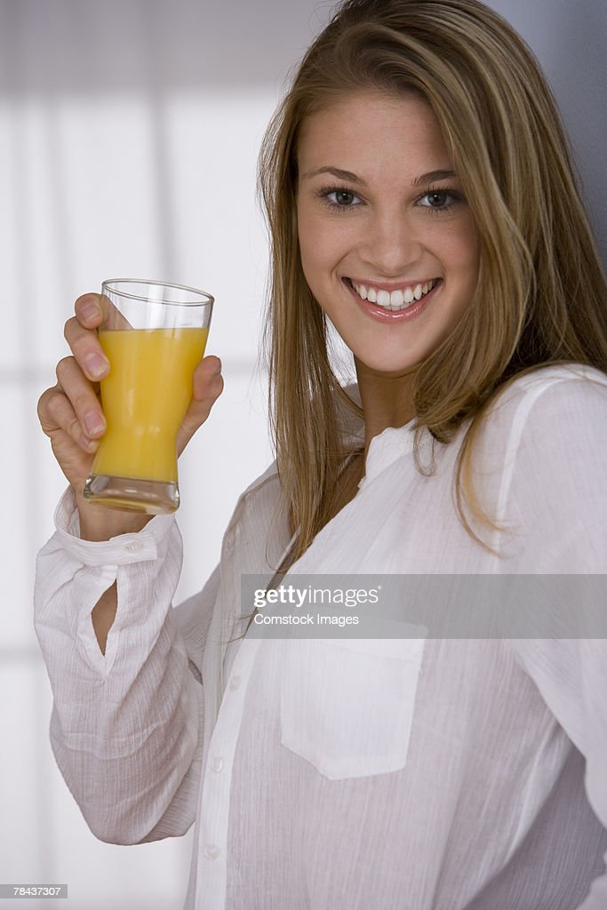 Woman drinking orange juice : Stockfoto