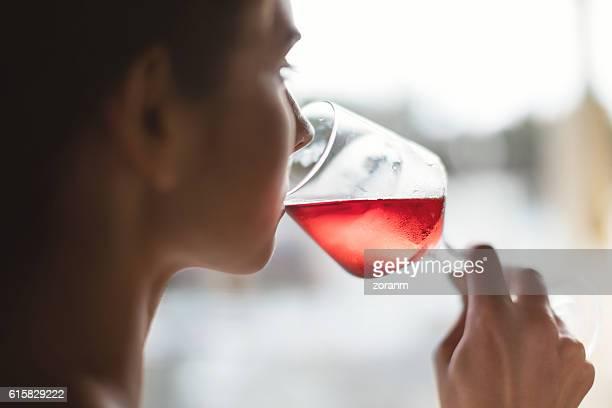 Woman drinking rose wine