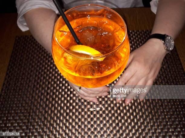 Woman drinking Spritz cocktail