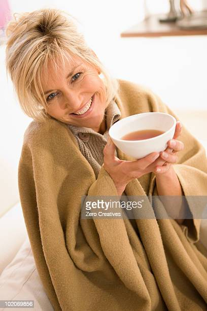 woman drinking tea - hot older women stock pictures, royalty-free photos & images