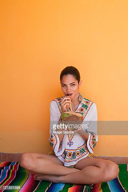 Woman drinking tropical fruit juice