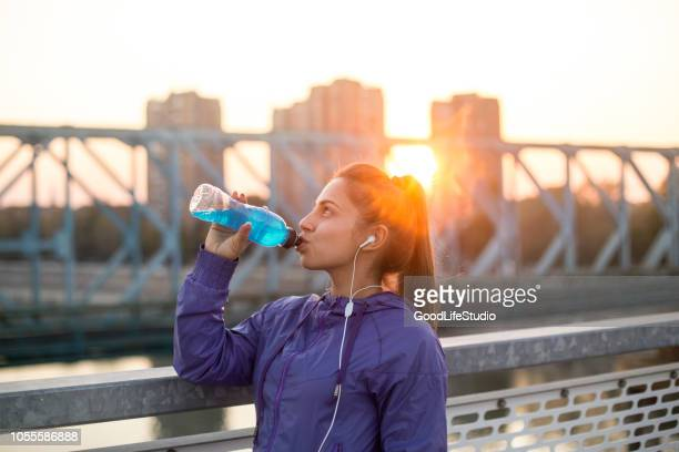 woman drinking vitamin water - energy drink stock pictures, royalty-free photos & images