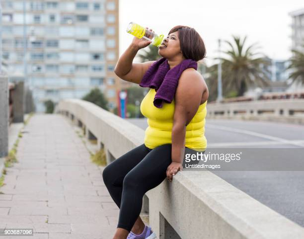 woman drinking water after exercise - energy drink stock pictures, royalty-free photos & images