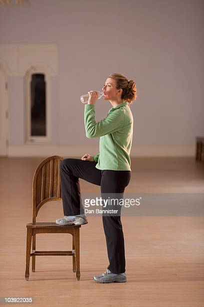 Woman drinking water after exercising