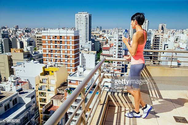 woman drinking water after training - palermo buenos aires stock photos and pictures