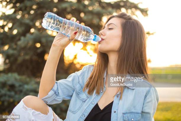 woman drinking water - drink water stock pictures, royalty-free photos & images