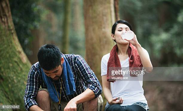 Woman Drinking Water while Hiking
