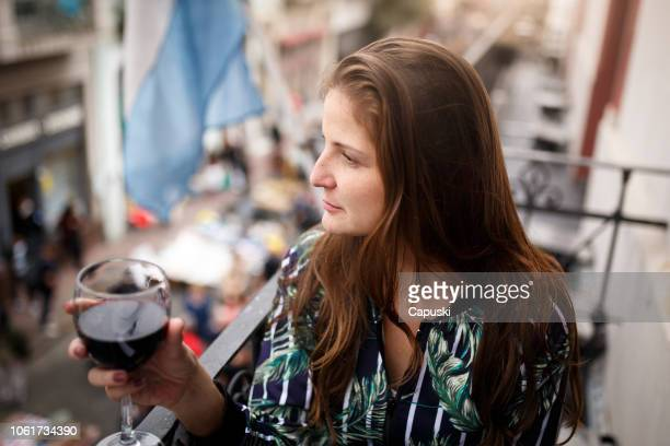 Woman drinking wine at rooftop restaurant