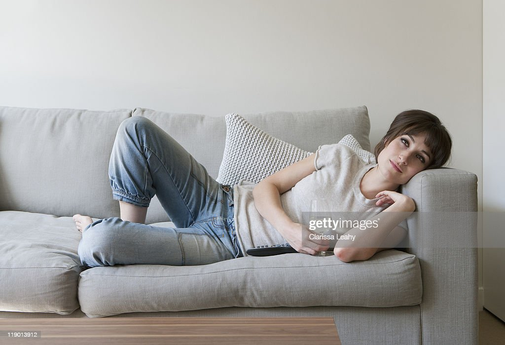 Woman drinking wine on couch : Stock Photo