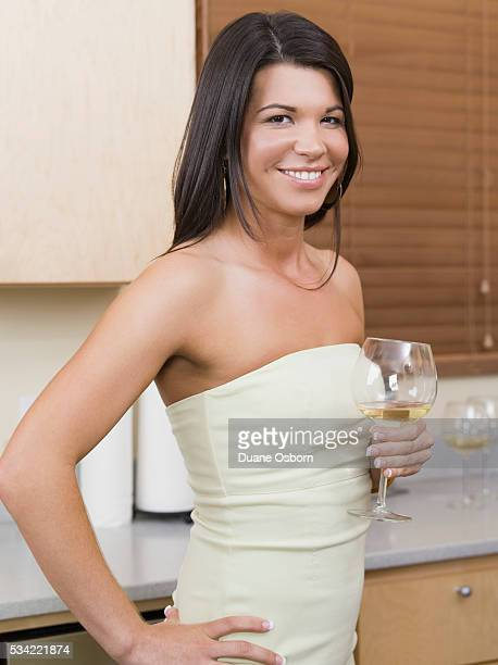 woman drinking wine - strapless dress stock pictures, royalty-free photos & images