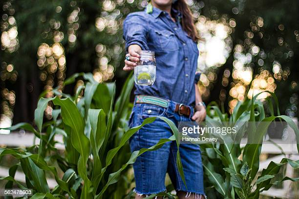 Woman drinks a beverage in her garden