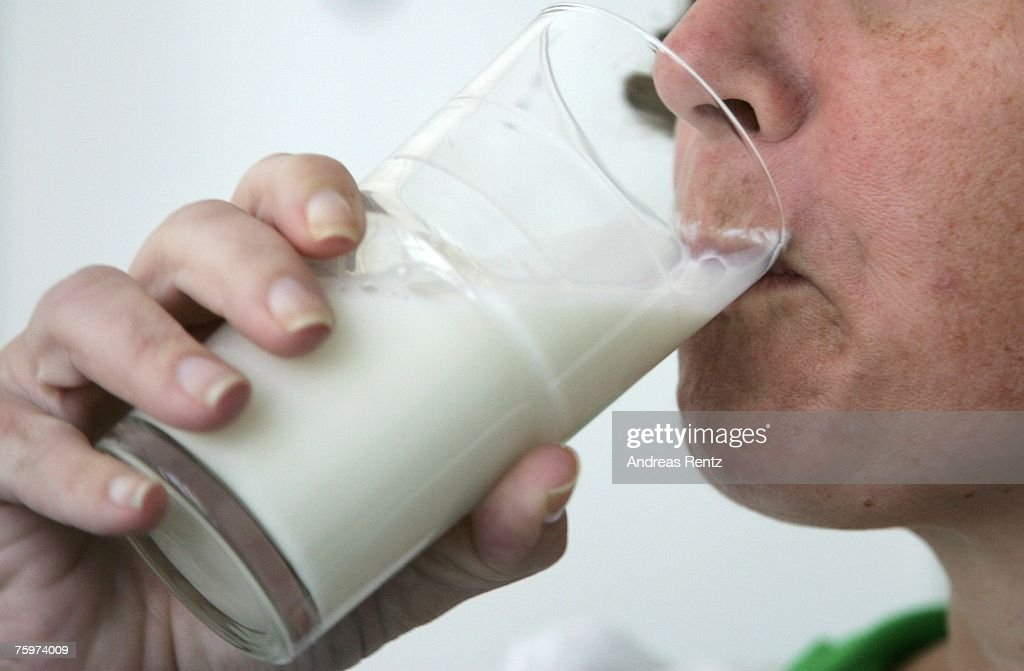 A woman drinks a glas milk on August 5, 2007 in Berlin, Germany. German milk producers have announced they will raise prices on milk and milk products starting July 31 nationwide by as much as 50%.