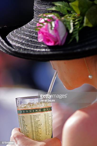A woman drinks a mint julep during the 132nd Kentucky Derby on May 6 2006 at Churchill Downs in Louisville Kentucky