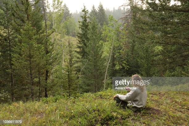 woman drinks morning coffee, while sitting in forest meadow - look back at early colour photography stock pictures, royalty-free photos & images