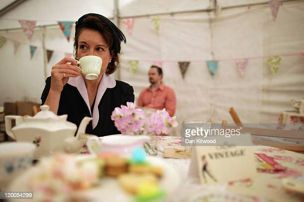 A woman drinks tea on a stand at the Vintage Festival on July 29 2011 in London England The Vintage Festival is currently being held at the Royal...