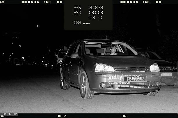 A woman driver getting caught speeding by a speed camera