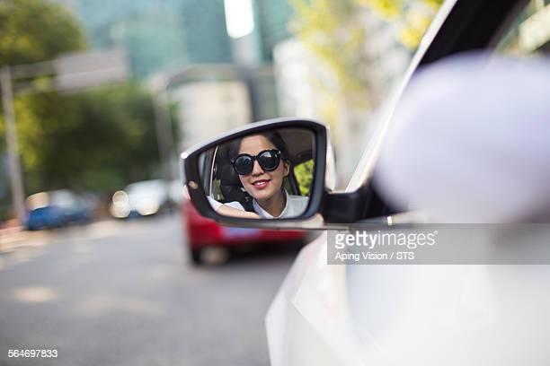 woman driver in car rear view mirror