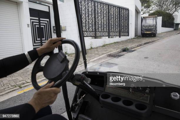 A woman drives a golf cart in Discovery Bay a residential project developed by Hong Kong Resort Co on Lantau Island in Hong Kong China on Tuesday...