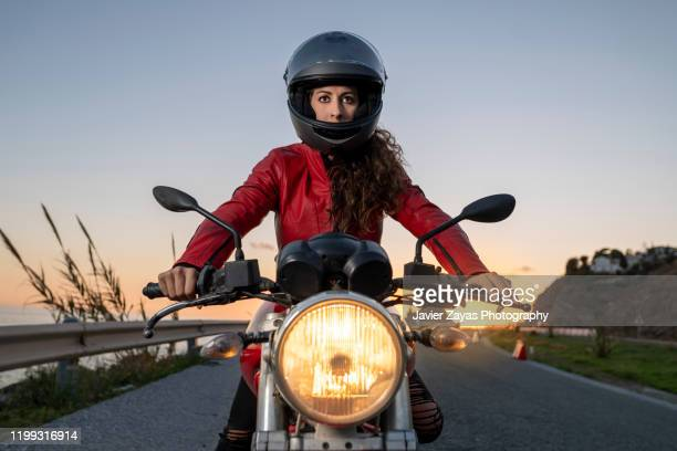 woman drives on a motorcycle - authority stock pictures, royalty-free photos & images