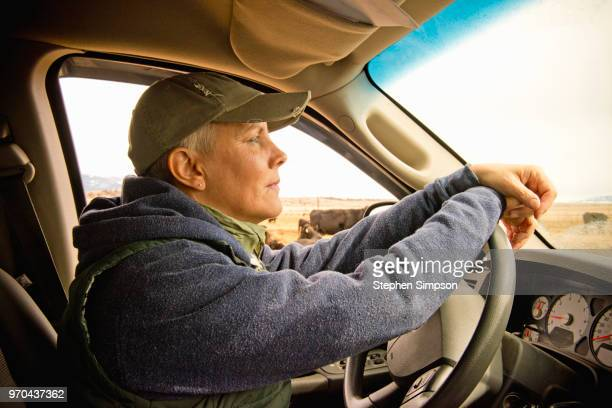 Woman drives truck on Montana ranch