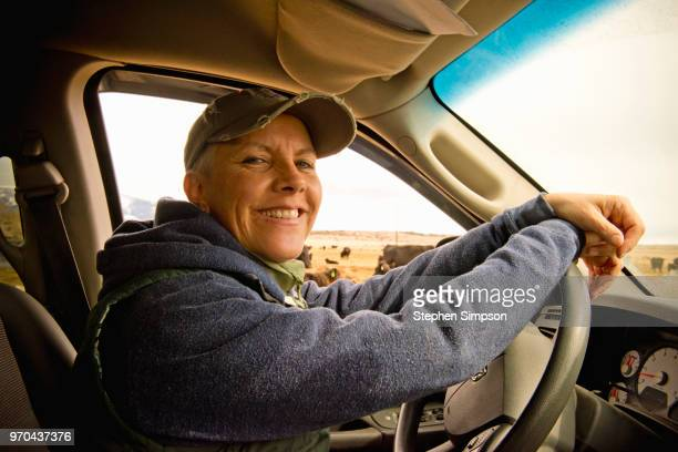 woman drives truck on montana ranch - montana western usa stock pictures, royalty-free photos & images