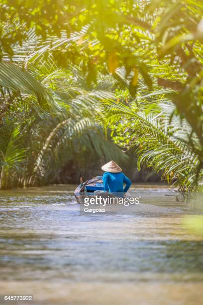 woman driving a boat in the mekong delta - vietnam stock pictures, royalty-free photos & images