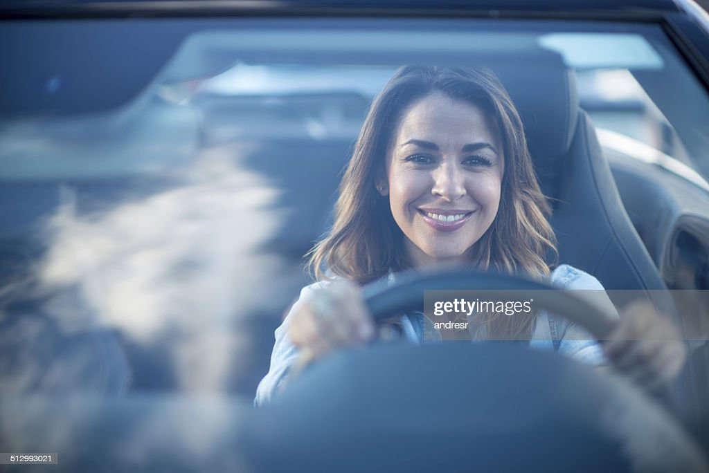 Woman driving a car : Stock Photo