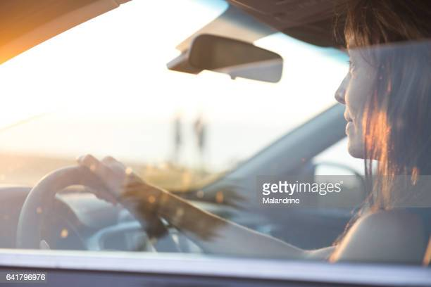 woman driving a car - driving stock pictures, royalty-free photos & images