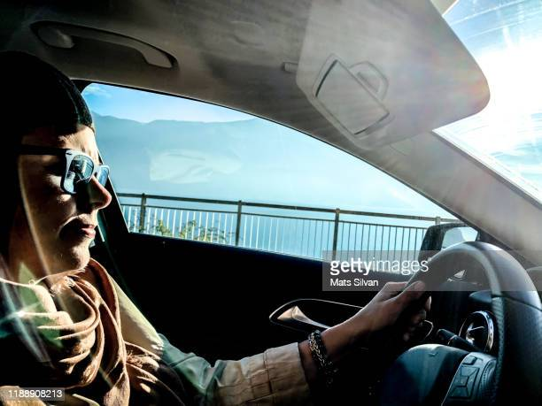 woman driving a car with sunlight - railings stock pictures, royalty-free photos & images