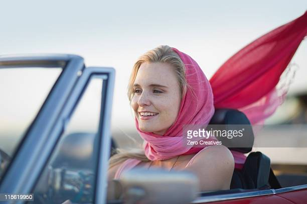 woman driving a convertible car - headscarf stock pictures, royalty-free photos & images