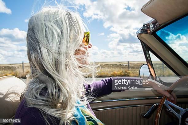 woman driving a convertible on a sunny day. - white hair stock pictures, royalty-free photos & images